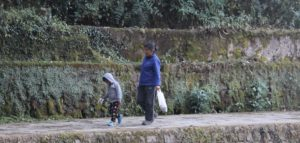 A leading walks with a child